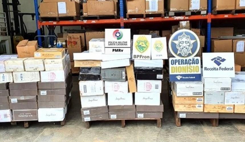 Forças de segurança e fiscalização apreendem carga de vinho argentino em caminhão